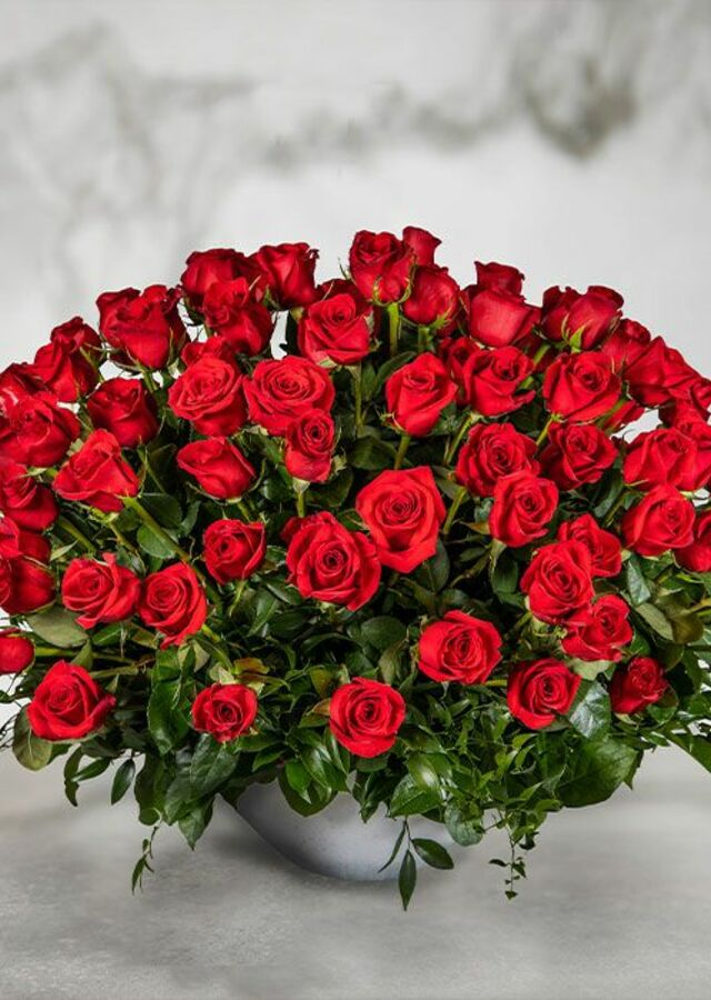 Display of 100 Roses by The Flower Alley