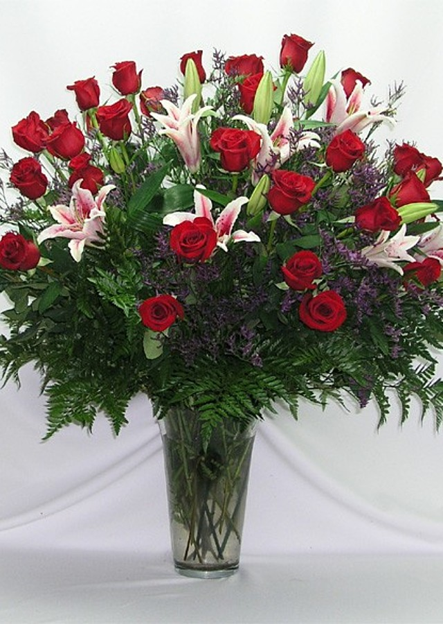 Display of 4 Doz Roses + Lilies by The Flower Alley