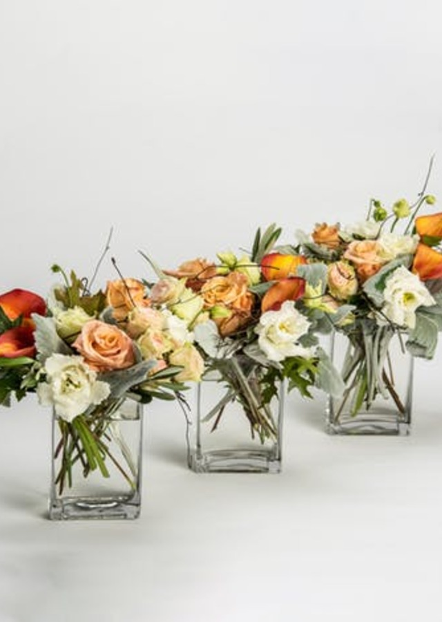 Display of Antique Trio Centerpieces by The Flower Alley