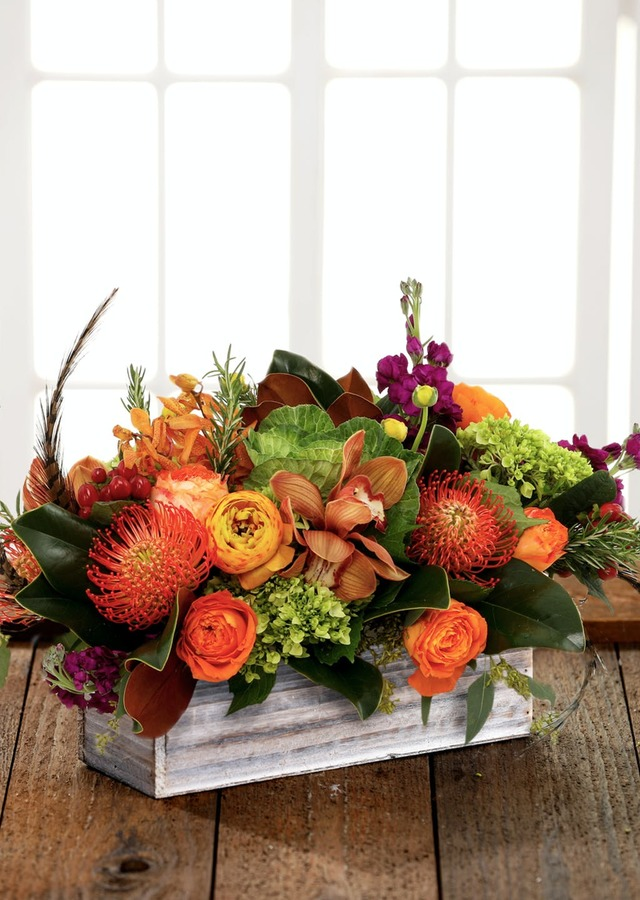 Display of Autumn Bonfire Centerpiece by The Flower Alley