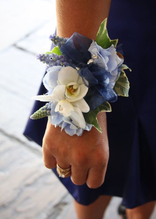 Display of Blue & White Wrist Corsage by The Flower Alley