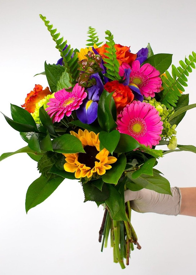 Display of Bright and Colorful Loose Wrapped Bouquet by The Flower Alley