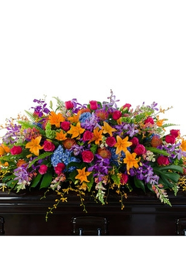 Display of Bright Full Casket Spray by The Flower Alley