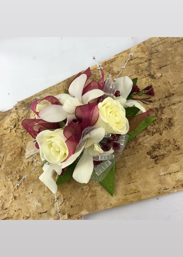 Display of Burgundy and White Corsage by The Flower Alley
