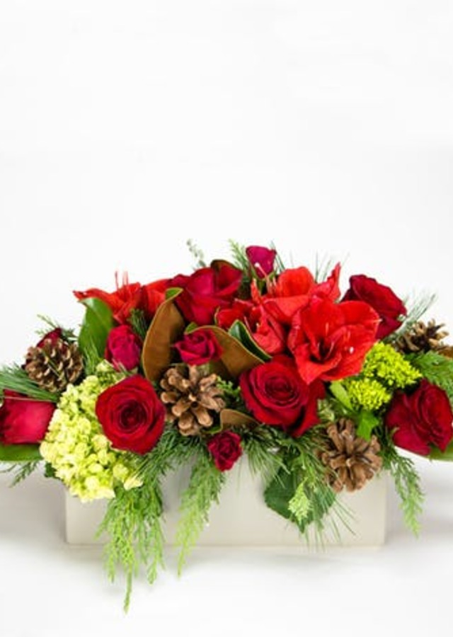 Display of Carols of Christmas Centerpiece by The Flower Alley