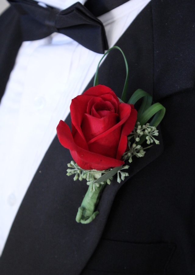 Display of Classic Red Rose Boutonniere by The Flower Alley