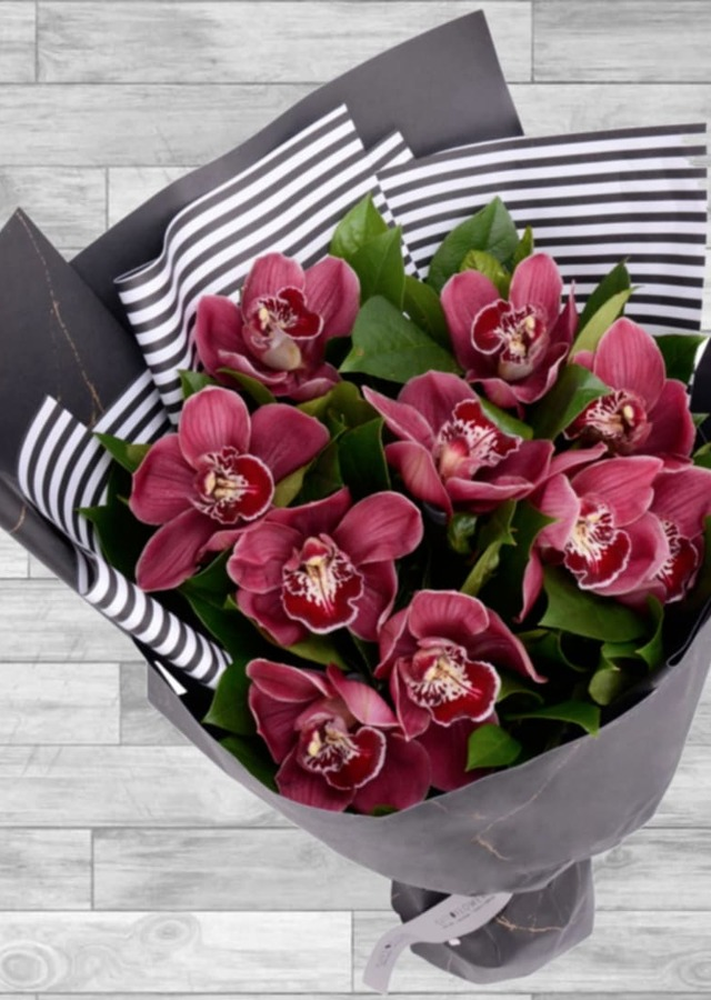 Display of Cymbidium Orchid Wrapped Bouquet by The Flower Alley