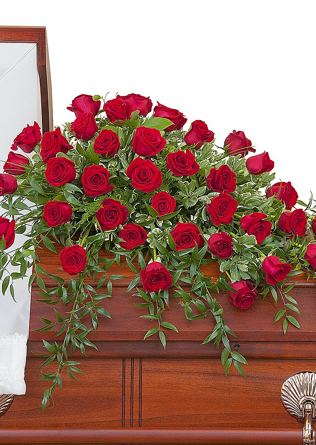 Display of Deluxe Roses Casket Spray by The Flower Alley