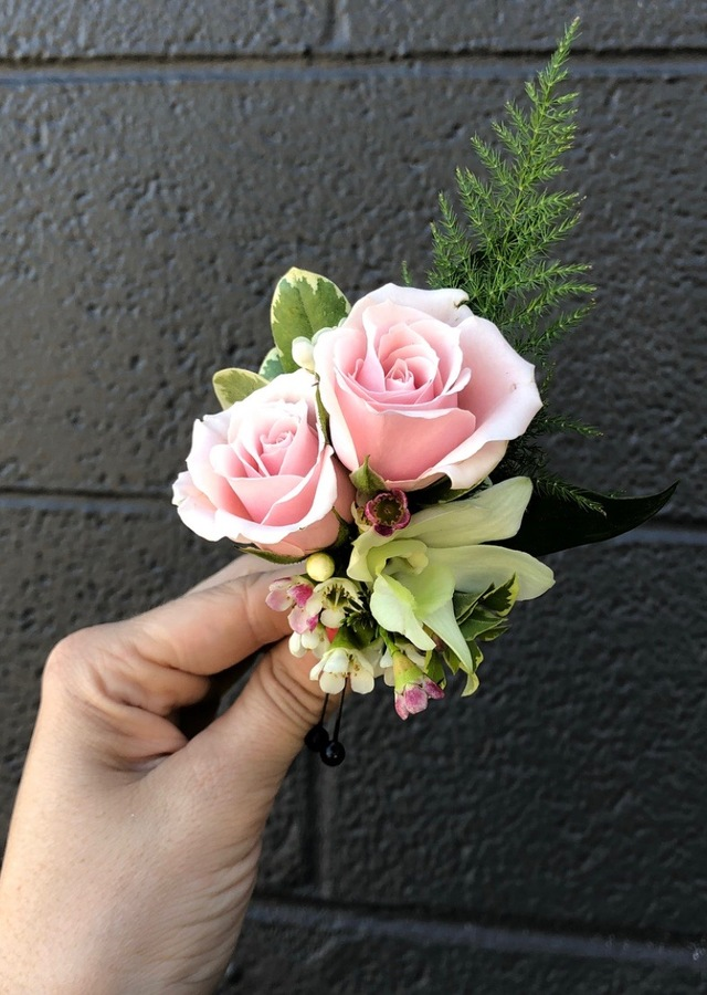 Display of Double Pink Boutonniere by The Flower Alley