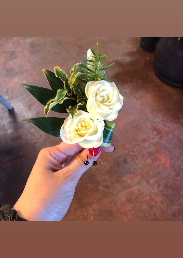 Display of Double White Boutonniere by The Flower Alley