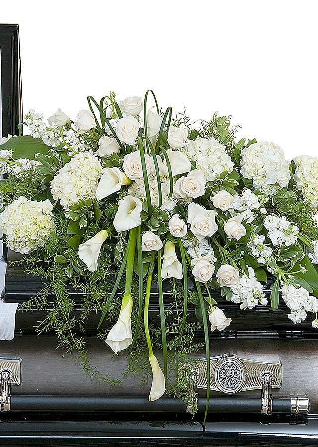 Display of Elegant Casket Spray by The Flower Alley
