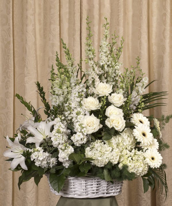 Display of Elegant White Wicker Basket by The Flower Alley