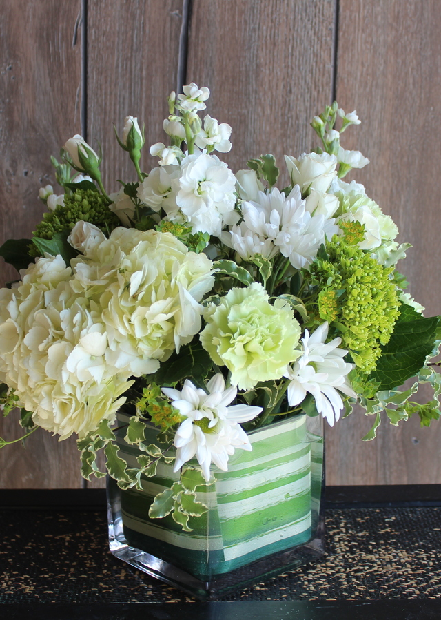Display of Emerald Elegance Spring Cube by The Flower Alley