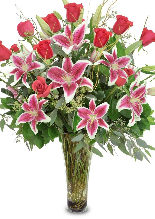 Display of Enchanted Roses & Stargazer Lilies by The Flower Alley