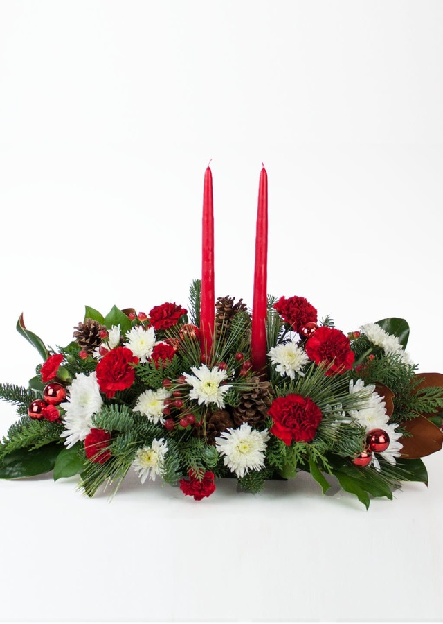 Display of Festive Christmas Centerpiece by The Flower Alley