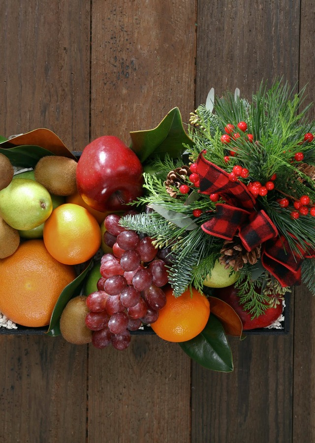 Display of Fruit Crate with Holiday Flowers by The Flower Alley
