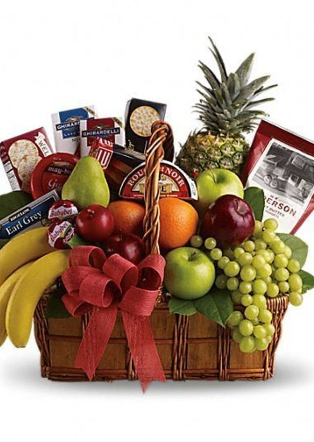 Display of Deluxe Fruit & Gourmet Basket by The Flower Alley