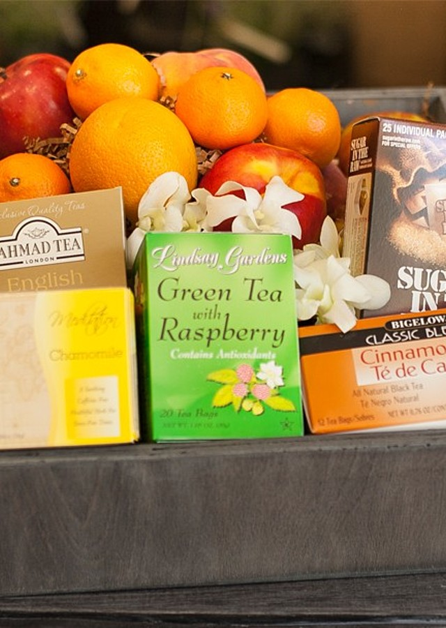 Display of Gourmet Tea and Fruit Crate by The Flower Alley