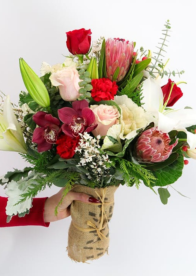 Display of Handful of Holiday (Hand tied bouquet) by The Flower Alley
