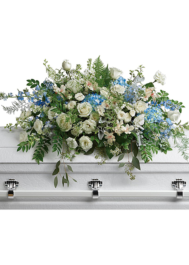 Display of Heavenly Heights Casket Spray by The Flower Alley