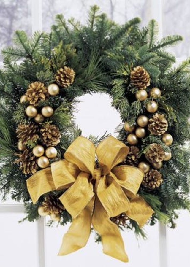 Display of Holiday Gold Wreath by The Flower Alley