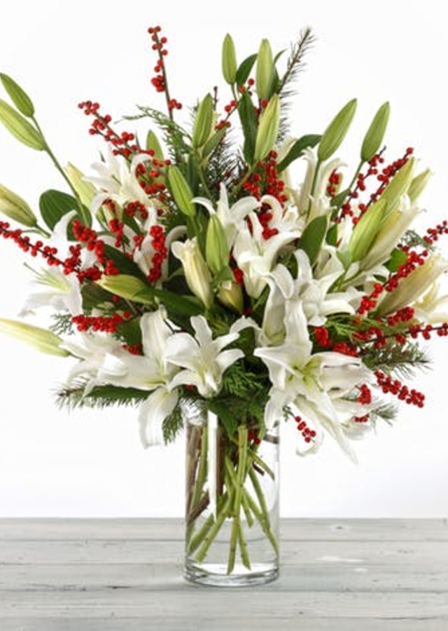 Display of Holiday White Lilies by The Flower Alley