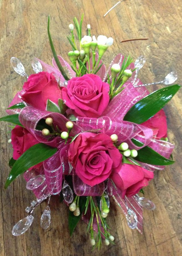 Display of Hot Pink Premium Corsage by The Flower Alley