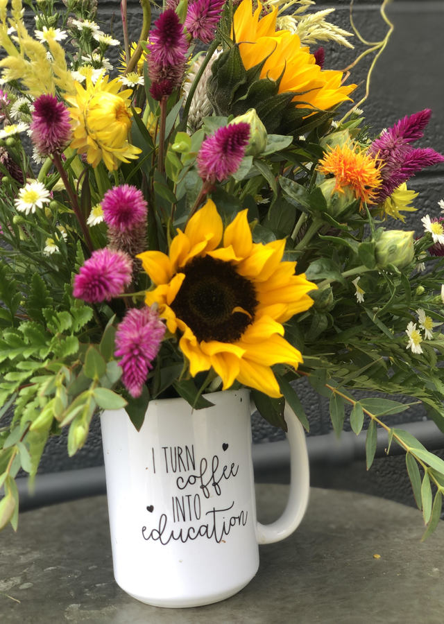 Display of I Turn Coffee Into Education by The Flower Alley