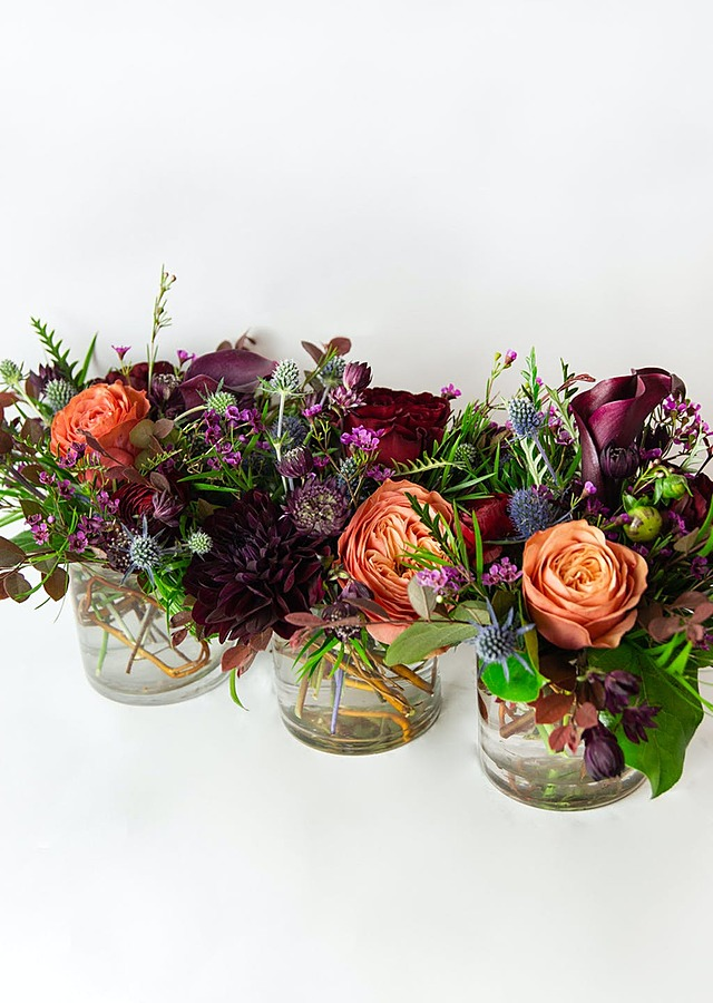 Display of Jewel Tone Trio Centerpiece by The Flower Alley