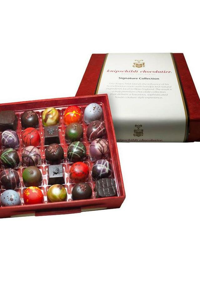 Display of Large Signature Collection Gourmet Chocolates by The Flower Alley