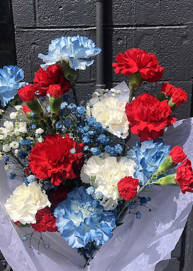 Display of Memorial Day Carnations Bqt by The Flower Alley
