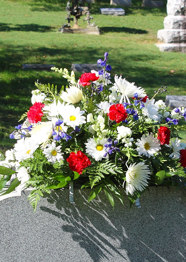 Display of Patriotic Cemetery Saddle by The Flower Alley