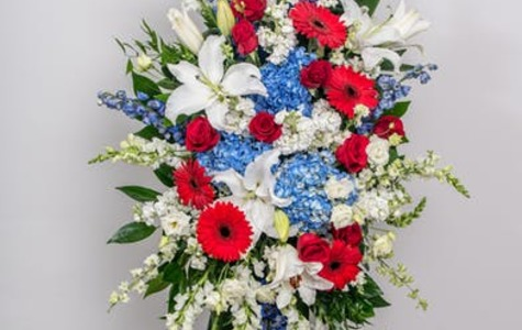 Display of Patriotic Standing Spray by The Flower Alley