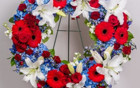 Display of Patriotic Standing Wreath by The Flower Alley