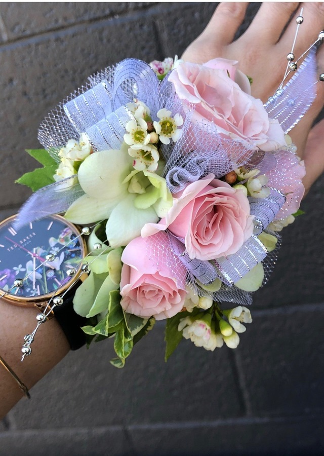 Display of Pink and White Wrist Corsage by The Flower Alley