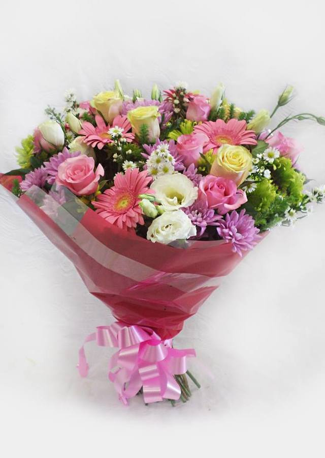 Display of Presentation Style Loose Wrapped Bouquet by The Flower Alley
