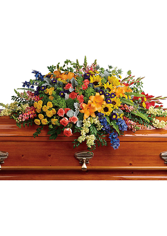 Display of Rainbow of Reflections Casket Spray by The Flower Alley
