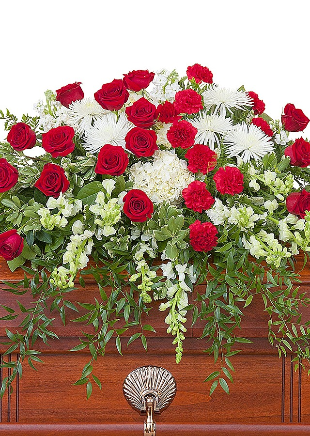 Display of Red and White Casket Spray by The Flower Alley