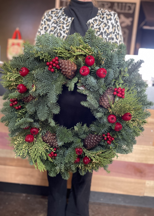 Display of Regal Fruit Holiday Wreath by The Flower Alley