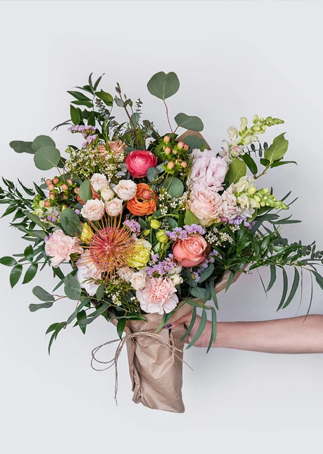 Display of Seasonal Spring Wrapped Bouquet by The Flower Alley