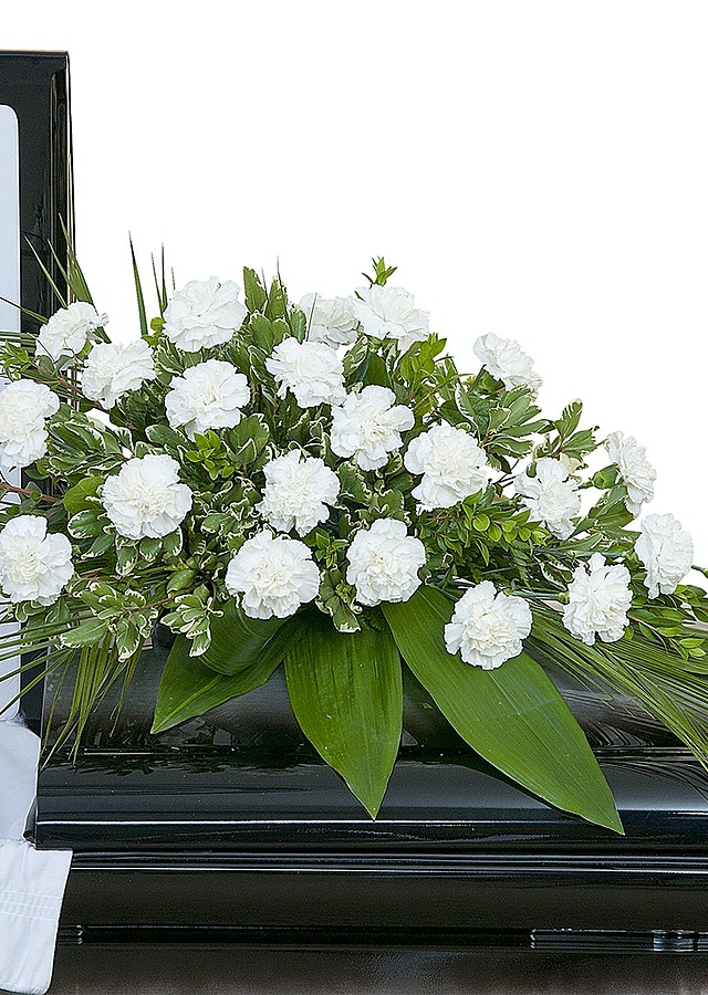 Display of Simple Casket Spray by The Flower Alley