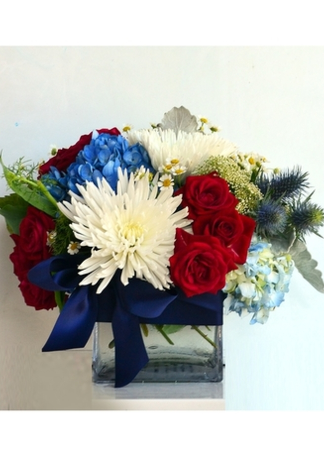 Display of Stars & Stripes Cube Arrangement by The Flower Alley