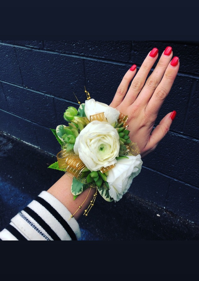 Display of Succulent and Ranaculous Corsage by The Flower Alley