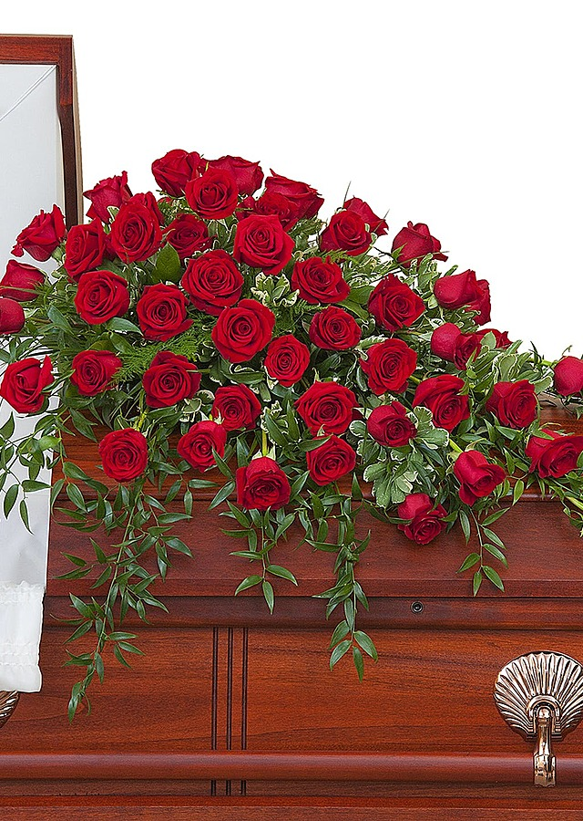 Supreme Roses Casket Spray by The Flower Alley
