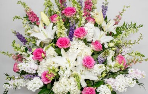 Display of Sympathy Basket in Pastels by The Flower Alley