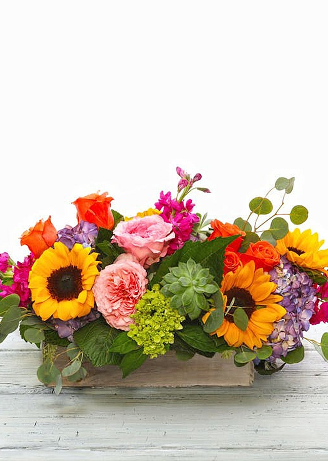 Display of Vibrant Garden Centerpiece by The Flower Alley