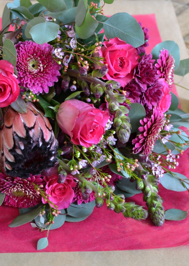 Display of Vibrant Pinks & Purples Designer's Choice Loose Bouquet by The Flower Alley