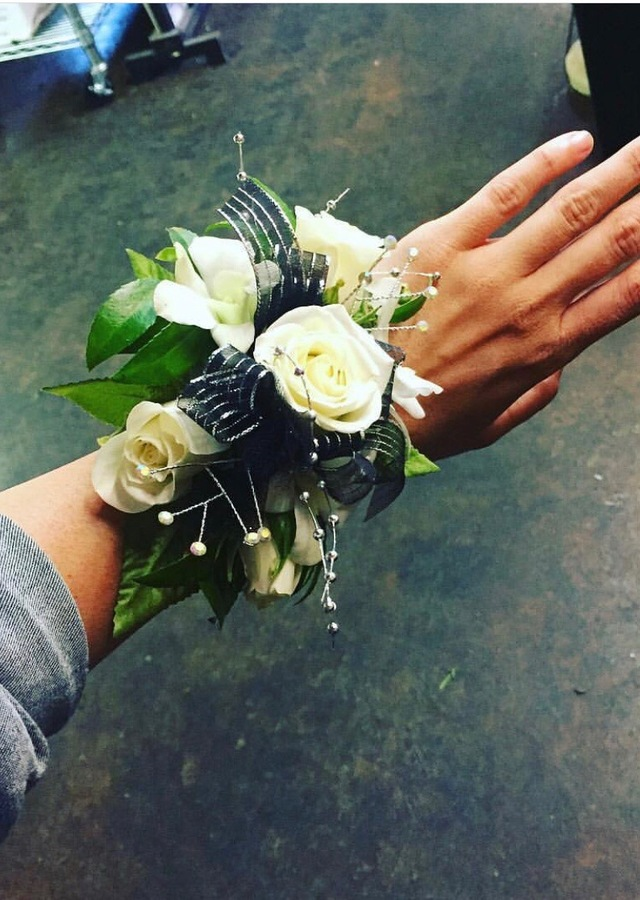 Display of White & Black Wrist Corsage by The Flower Alley