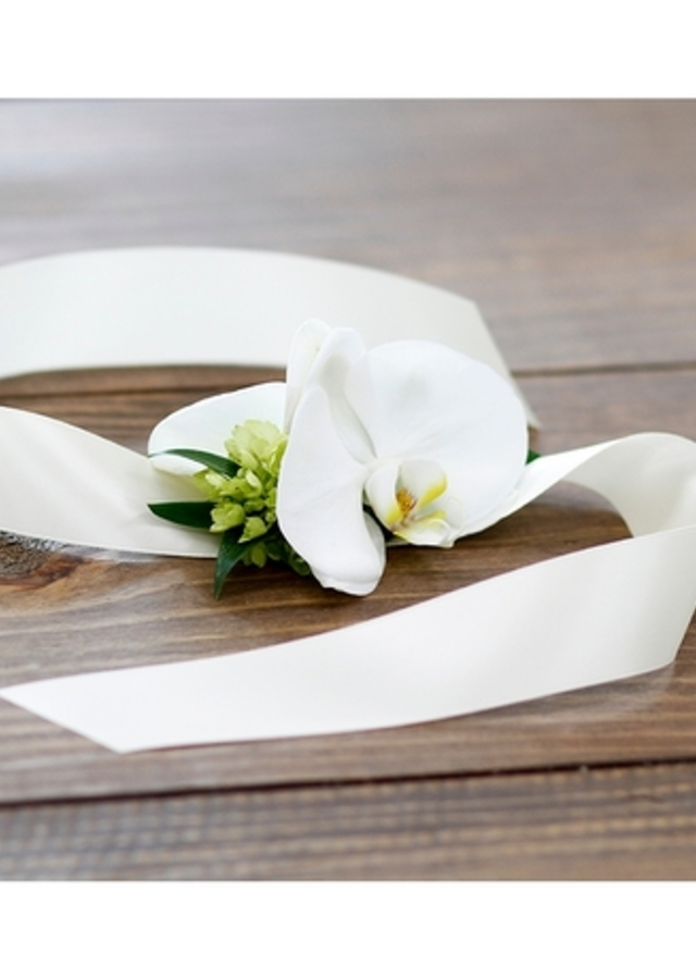 Display of White Orchid Corsage by The Flower Alley
